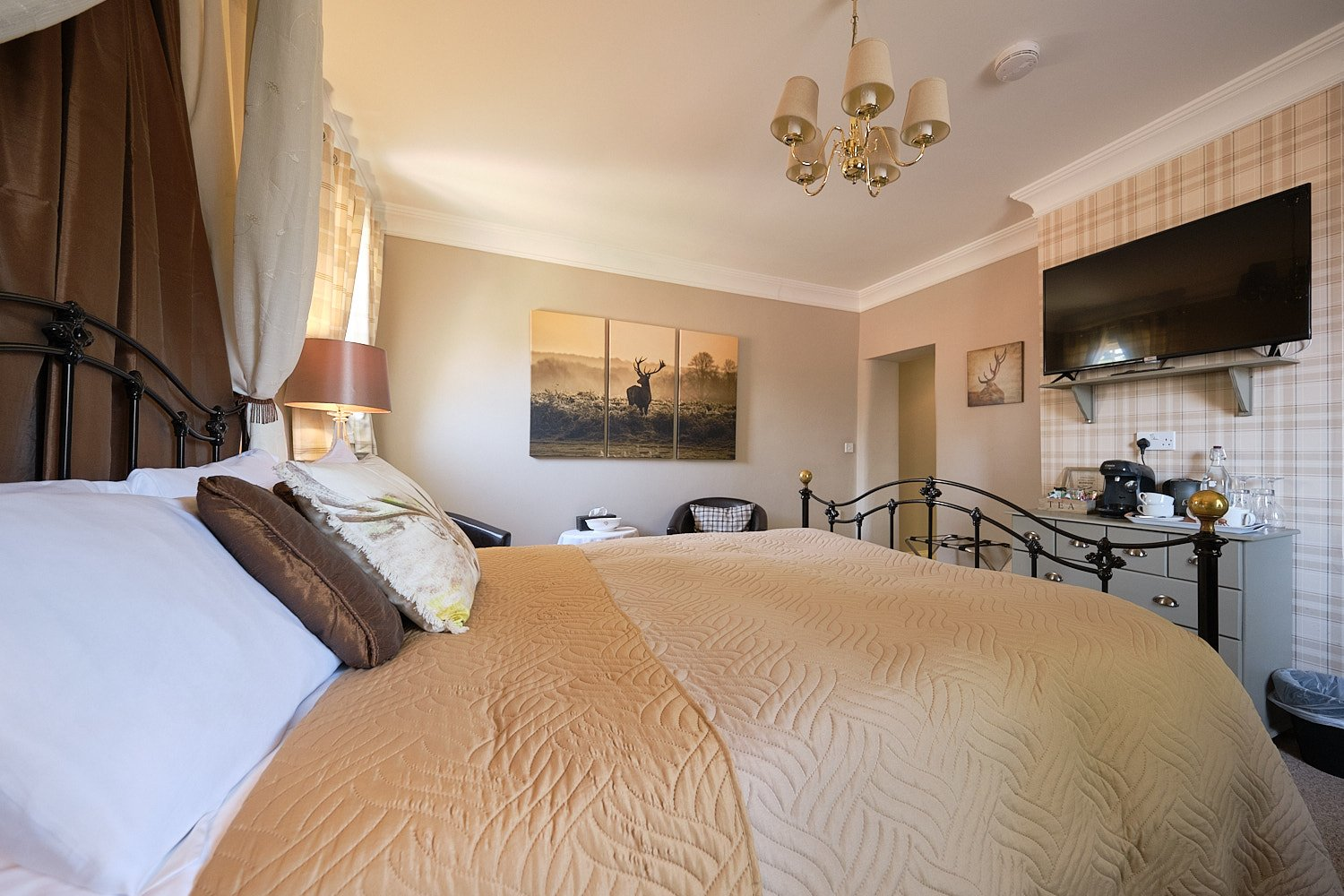 Looking across the bed to the door of Hamish Room at The Elm TreeHUndelby