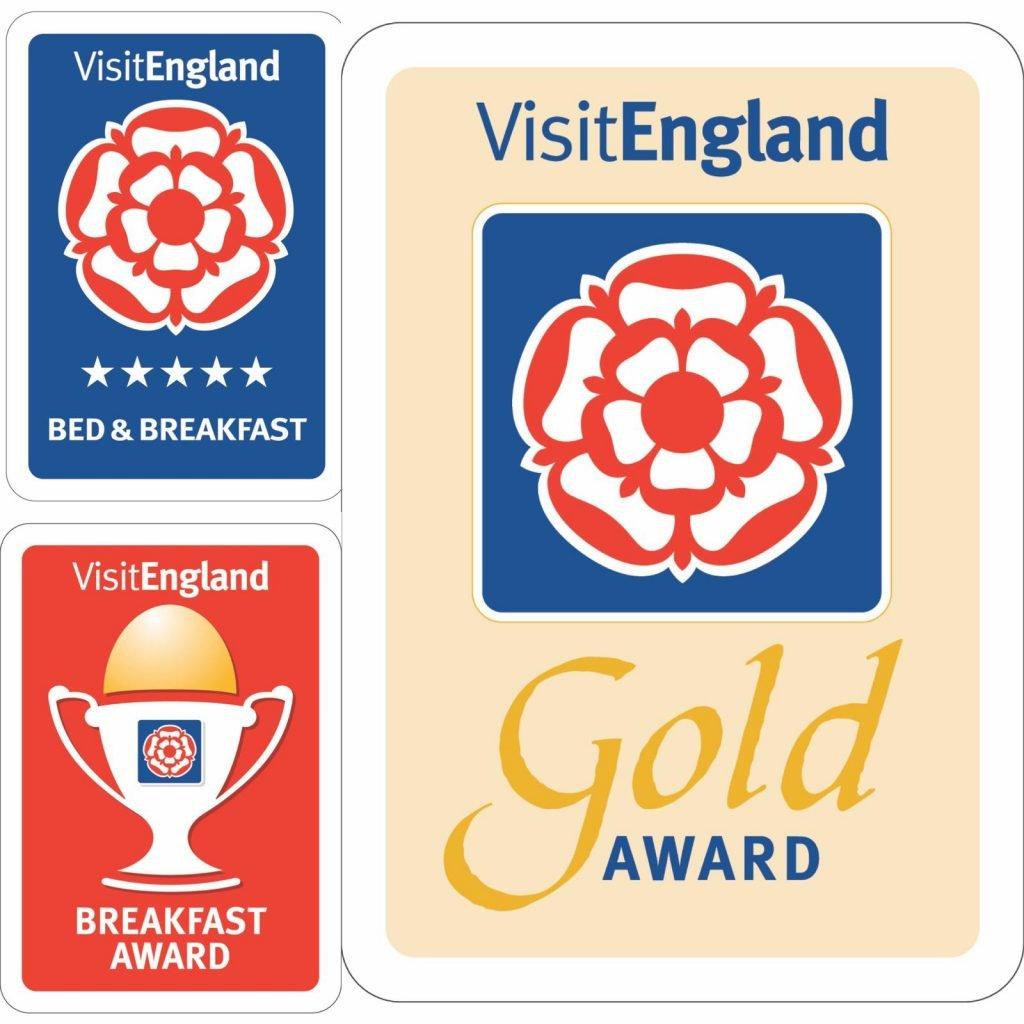 Visit England Gold Award and breakfast champion logos.